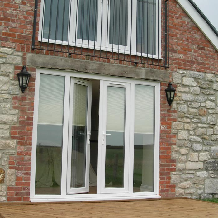 Upvc internal exterior french doors sharpes windows for Upvc french doors